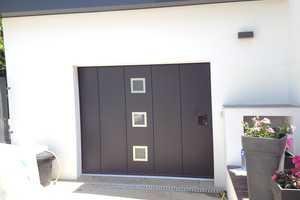 portes de garage en pvc bois aluminium ou acier france fermetures. Black Bedroom Furniture Sets. Home Design Ideas
